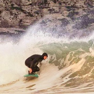 International surfing day I've not been in much since February and this is probably the last shot of mr surfing, full mid winter mode, hood, boots and micro head dip